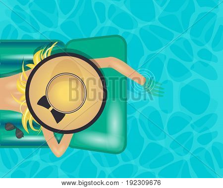 Woman lying on air mattres and wearing a big hat touching the water with one hand