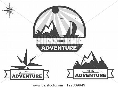 Adventure travel logo with black and white compass
