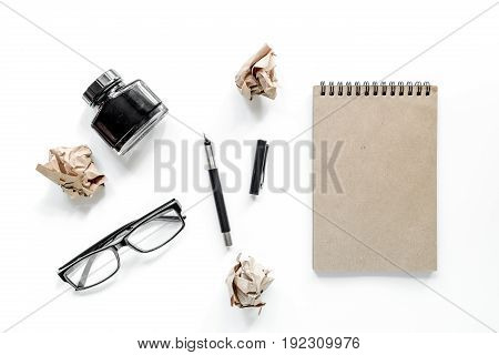 Writer concept. Glasses, pen and notebook on white background top view.