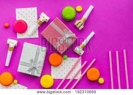 Birthday greeting cards and wrapped gifts on fuchsia background top view copyspace.