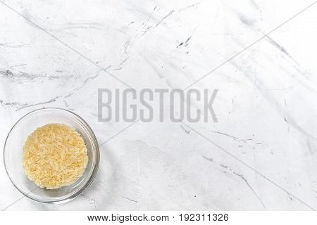 paella home cooking with rice for ingredients on white kitchen table background top view space for text