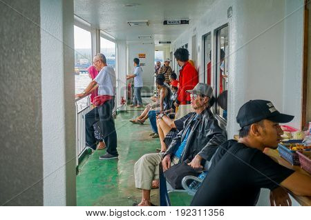 BALI, INDONESIA - APRIL 05, 2017: An unidentified people enjying the beautiful view from the ferry boat in Ubud, Bali Indonesia.