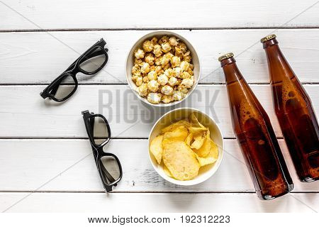 watching TV set with chips, beer and glasses on white background top view