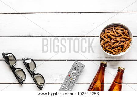 home party with TV watching, snacks and bread crumbs and beer on white background top view mock up