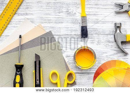 Preraring for home repair. Tools on grey wooden desk background top view.