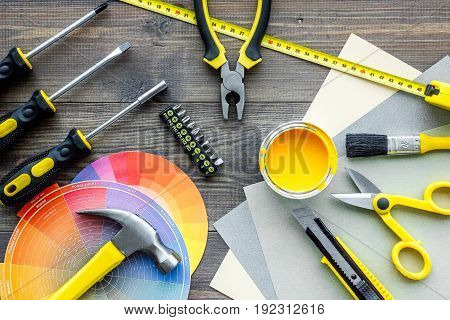 Set of construction tools on wooden background top view.