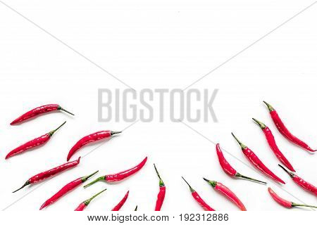 cooking hot sauce with red chili pepper on white kitchen table background top view mock up