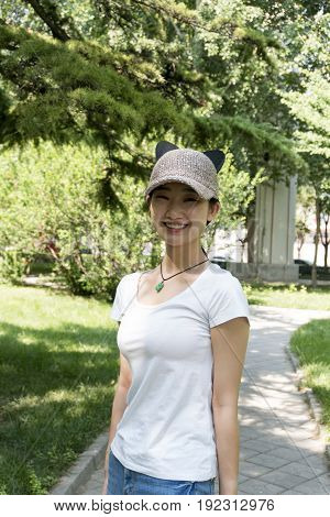 Happy Asian Girl Smiling Portrait. In The Park.