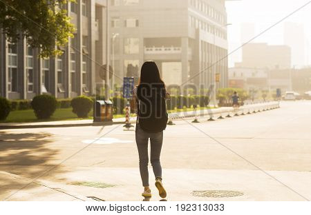 Girl Carrying A Bag In Campus Back View
