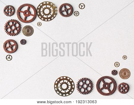 Metal gears and machine parts on a white background
