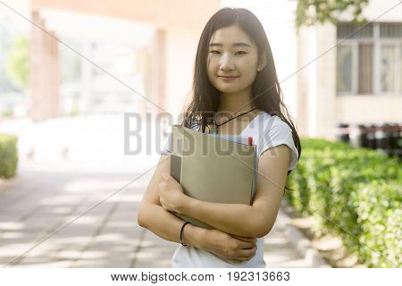 Portrait Of A Asian College Student At Campus