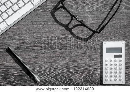 accountant work desk with calculator and keyboard for online payment on dark background top view space for text