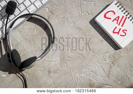 customer support service desktop with contact us copy on stone background top view mockup