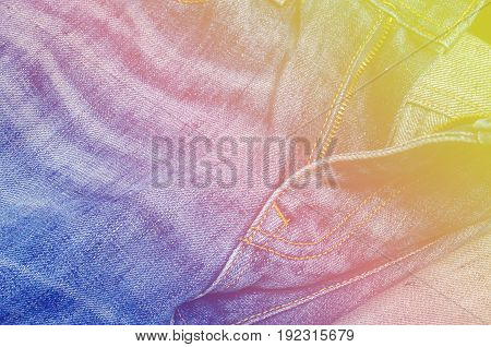 Closeup denim jeans texture. Sewing background blue jeans texture. Colorful designs on jeans book a beauty.