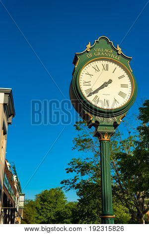 GRANVILLE OH - MAY 15 2017: An old-fashioned outdoor clock stands outside the village hall on Broadway in this quiet east-central Ohio village.