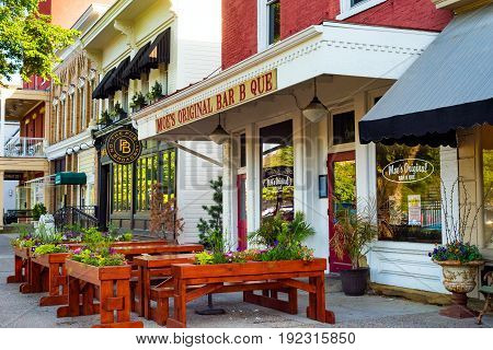 GRANVILLE OH - MAY 15 2017: Sidewalk seating is a feature at Moe's Bar B Que and other establishments on the main street of this charming east-central Ohio village.