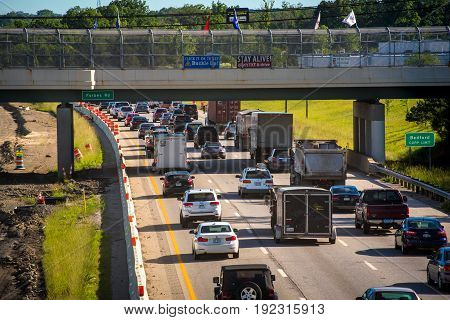 BEDFORD OH - JUNE 8 2017: Morning traffic is at a crawl on I-271 southeast of Cleveland because of road construction with new lanes being added.