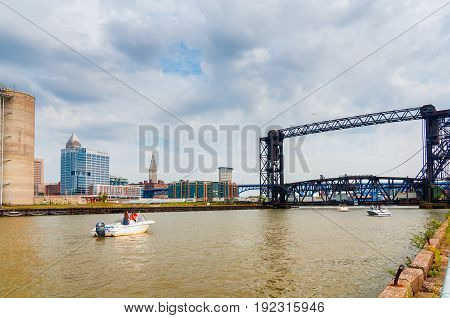 CLEVELAND OH - SEPTEMBER 4 2015: Pleasure boats near the mouth of the Cuyahoga River wait for the railroad lift bridge to rise so they can head upstream.