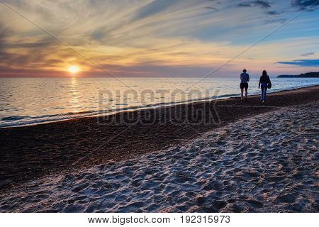 young couple in love on sunset background
