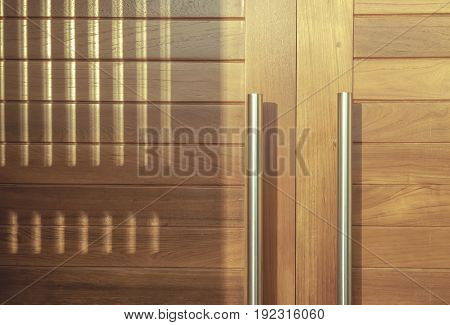 Modern wooden door with sunlight in the morning