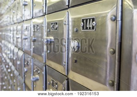 Rows of metal post office boxes. Closeup