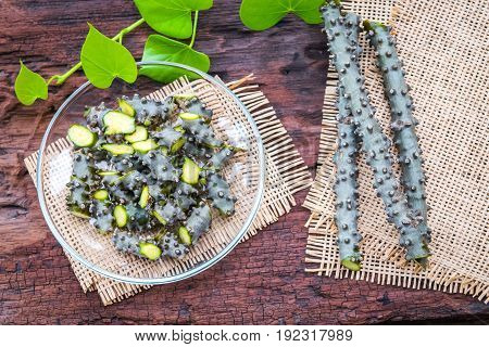 Tinospora cordifolia herb on old wooden background