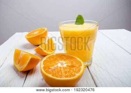 Glass of orange juice on a white table. Orange. Concept of sweet and fresh drink. Juice.