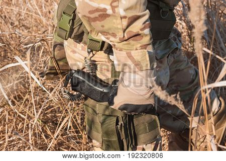 Close up picture of soldier hand and handgun
