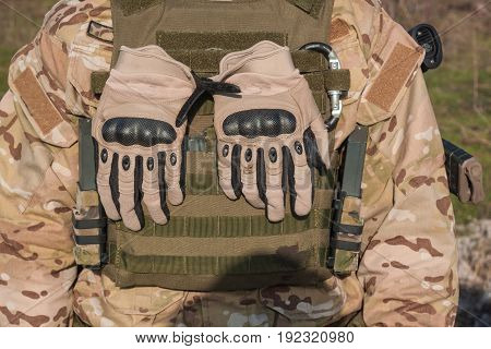 Cluse up picture of NATO soldier equipment, parts of modern soldier uniform