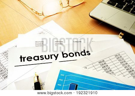 Papers with title treasury bonds. Trading concept.