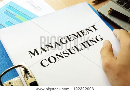 Folder and papers with title Management consulting.
