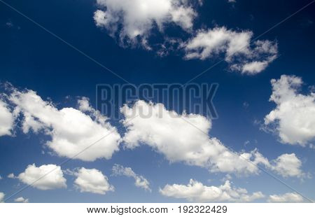 Clouds in deep blue summer sky high resolution photo natural background