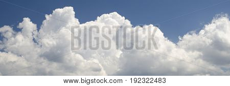 White clouds in deep blue summer sky panoramic view