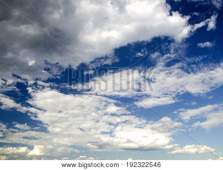 Clouds in deep blue summer sky natural background