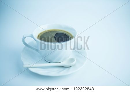 Coffee in white cup on white background