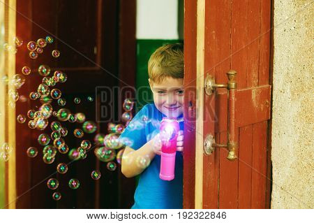 the boy blow bubbles . The concept of children's summer games