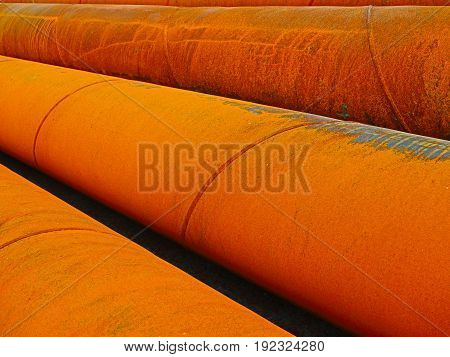 Rusty gold colored metal water pipes background.