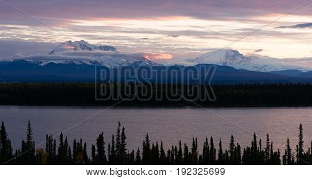It's sunrise in Alaska over Willow Lake and Mt. Blackburn