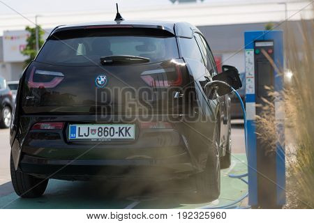 Ljubljana, Slovenia - June 21, 2017: i3 BMW electric car being charged at electric car charging station on 21th of June, 2017 in Ljubljana.