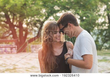 Young attractive couple in love having fun outdoors.