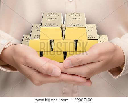 hand holding 3d rendering heap of bullion