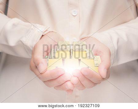 hand holding 3d rendering heap of gold bullion