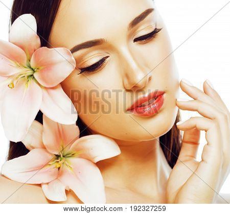young attractive lady closeup with hands on face isolated flower lily brunette spa nude makeup macro