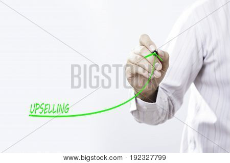 Businessman draw growing profit graph thanks upselling