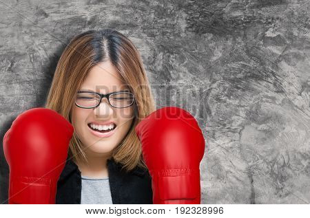 woman fighting concept with asian woman wearing red boxing gloves