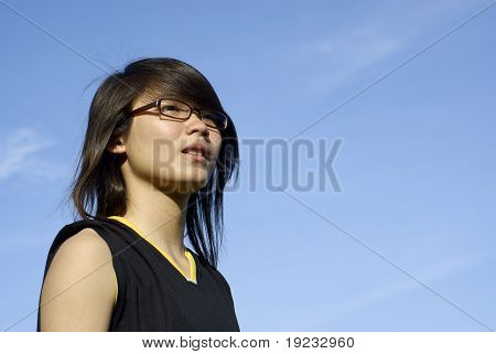 Asian teen girl looking to the future