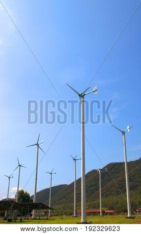 Wind Turbine Farm With Blue Sky And Clouds