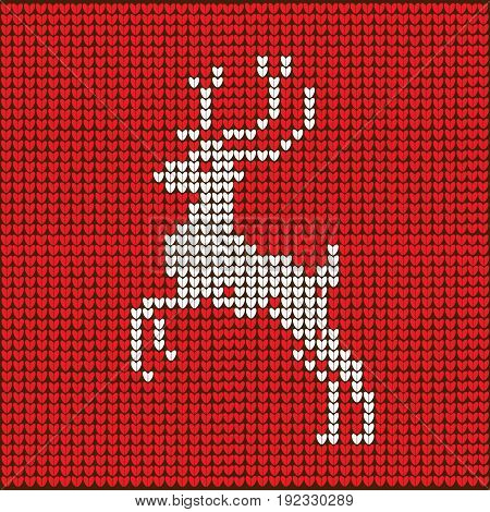 Knitted red Christmas background with reindeer. vector