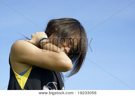 Asian girl with sore neck