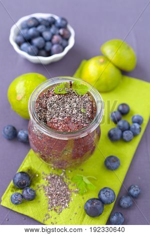 Healthy vegan chocolate chia pudding with fresh blueberries.